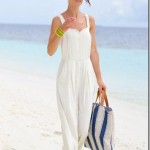 This fabulous white jumpsuit paired with bright yellow bangles and a blue and white striped tote is a                                                  fresh summertime look and a definite DUO.The look is effortless and carefree for a stroll on the beach.